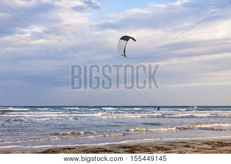 Kitesurfing in a cloudy autumn day. Lady's Mile beach in Limassol Cyprus