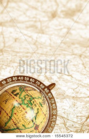 old globe on background of map