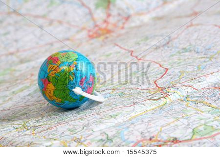 globe on background of map