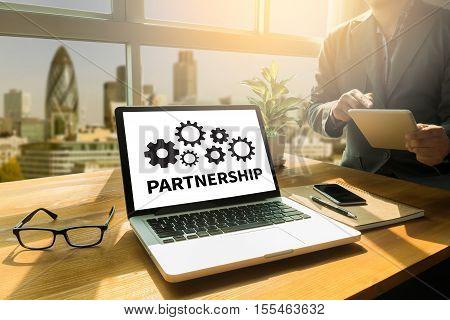 PARTNERSHIP Strategic Partnership on the gearwheels background, boss, business