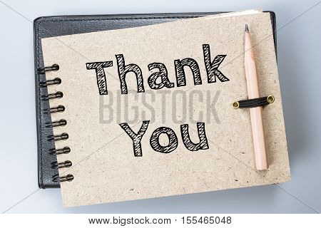 Thank you, Text message on brown Notebook / business concept