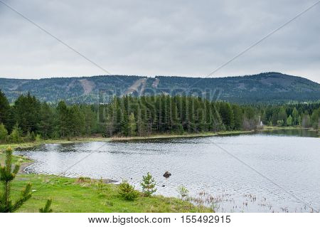 autumn, pond and a pine forest, autumn, pond, lake, coniferous forest, mountains covered with forests, mountain pond
