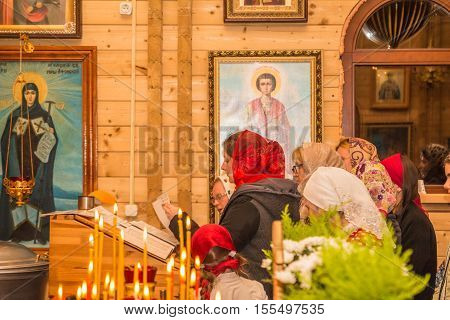 People In A Small Temple At The Altar. Dobrush, Belarus