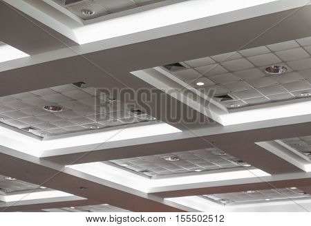 light neon from ceiling of business office building
