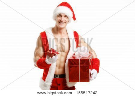 Sexy fitness Santa holding a red boxes. Muscular Santa Claus holding Christmas present in red box. Fitness Santa Happy New Year. Bodybuilder Santa with red box on a white background. Sexy Santa Claus