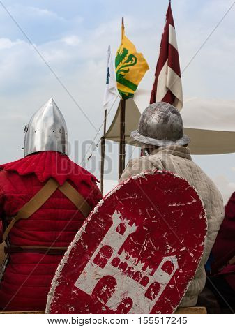 Knights With Silver Helmets And Shields Seated On Chair