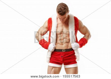 poster of Muscular fitness man in a suit of Santa Claus. Fitness Santa Claus with perfect muscular body showing six pack abs. Strong Athletic Man Fitness Model Torso showing six pack abs. Santa Claus isolated