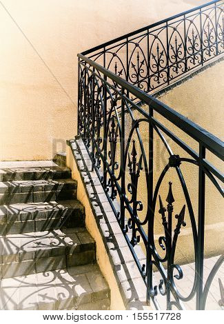 old stairs of concrete outdoors black steel railing with a yellow wall perspective city architecture retro style