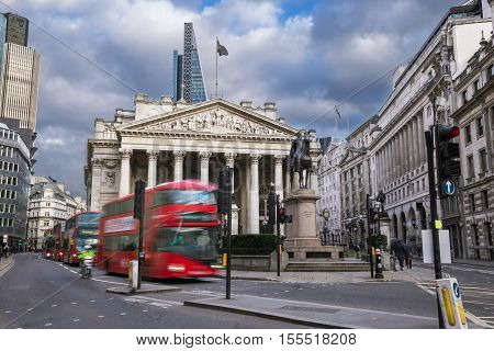 London England - The Royal Echnage building with moving red double decker bus