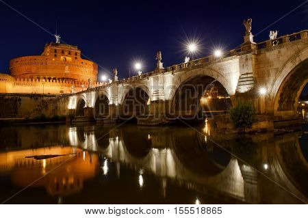 Castel Sant'Angelo and river Tiber scenic view at night Rome Italy