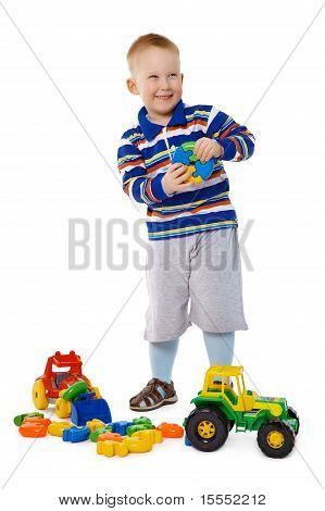 Child Playing With Toys On White Background