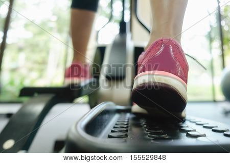 Close up of Runner feet at a fitness gym vintage tone still life.soft focus(selective focus).
