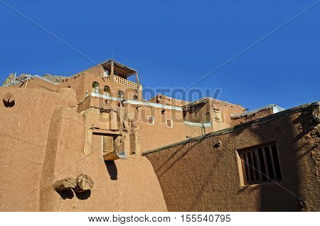 landscape view of traditional red clay houses at desert mountain village of Abyaneh in the iranian county of Natanz next to Isfahan city in Iran country in Islam tourism and traveling