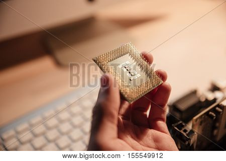 Closeup of man hand working and holding CPU