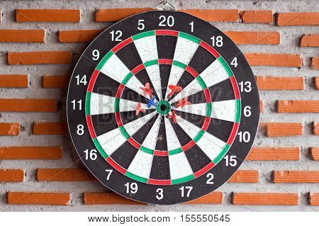 hit group of target in dart game on brick wall