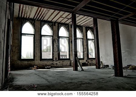 A photo of the interior of an old abandoned industrial building.