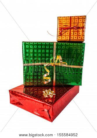 Pile of gift boxes of various sizes and colors isolated on white background