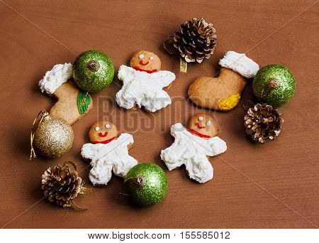 Christmas homemade cookies with cream on wooden background. Selective focus