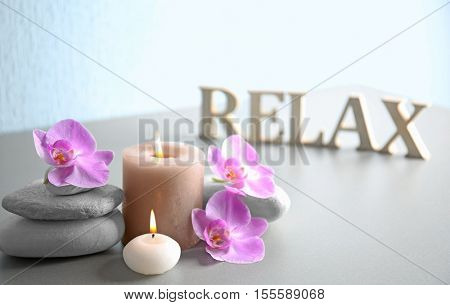 Spa composition and word RELAX made of wooden letters on table