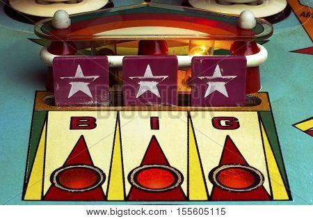 Star drop targets of a retro pinball machine