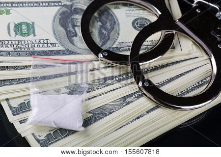 Handcuffs On Dollar Banknotes Fan And Cocaine