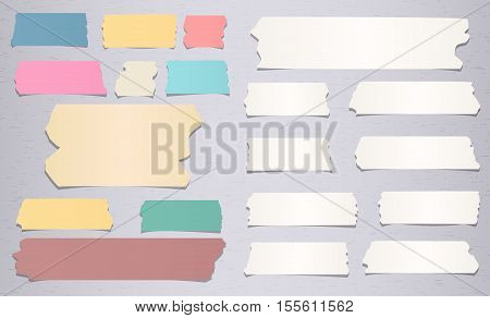 Colorful and white different size sticky, adhesive masking tape are on grey background.