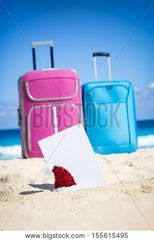 Empty Greeting Card With Luggage On Christmas Beach