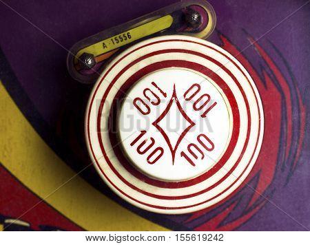 Overhead of 100-point bumper on retro pinball machine