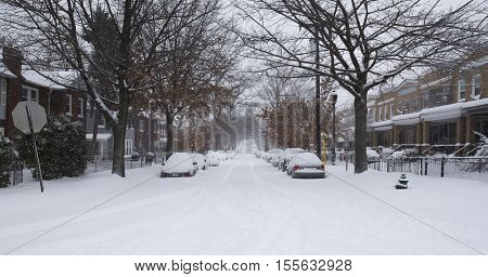 Washington D.C. USA - January 23 2016: snow covered cars during a snowstorm
