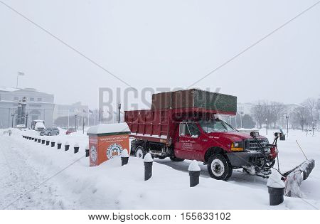 Washington D.C. USA - January 23 2016: Snow machine cleans the street during a snowstorm