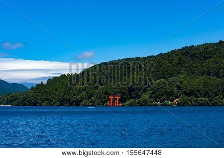 Bright Red Torii Gate On Ashi Lake