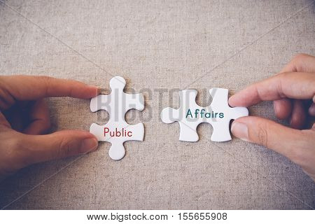 Hands with puzzle pieces and