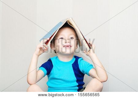 Smiling Boy Missing Milk Tooth With Book