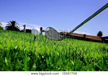 ball and golf clubs on the bright green grass - as a symbol of success