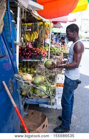 African American Man Buys Coconuts
