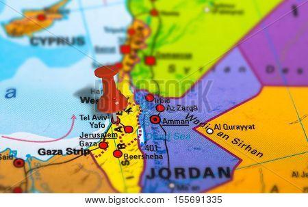 Tel Aviv in Israel pinned on colorful political map of Middle East. Geopolitical school atlas. Tilt shift effect.