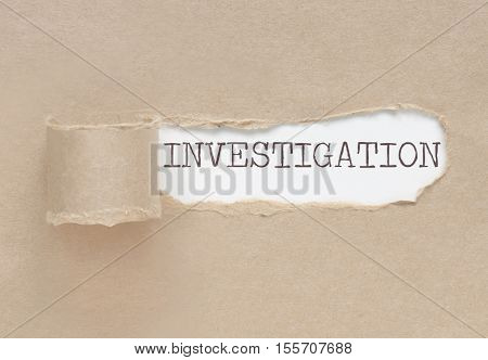 Torn paper revealing the word investigation underneath