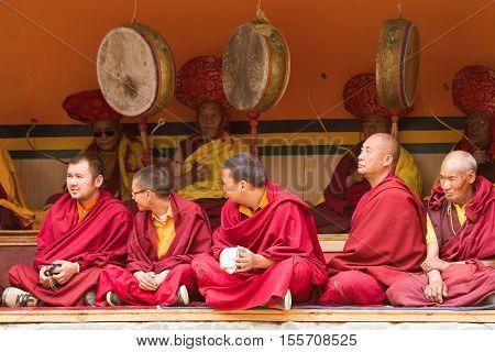 Lamayuru India - June 17 2012: Gelug-pa monks as attentive spectators and ritual drummers at the Cham Dance Festival of Tibetan Buddhism in Lamayuru monastery Ladakh India