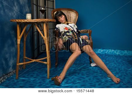 Lifeless Woman Sitting In A Chair