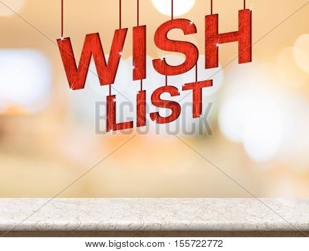 Wish list word hanging over marble table with blurred bokeh light backgroundHoliday card.(3d rendering)