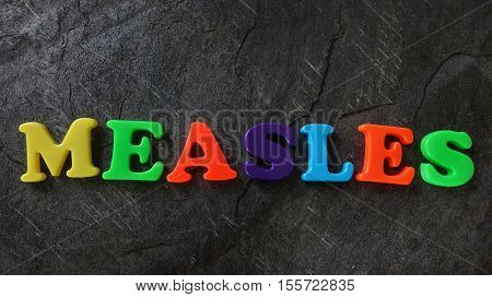 Colorful play letters spelling out the word Measles