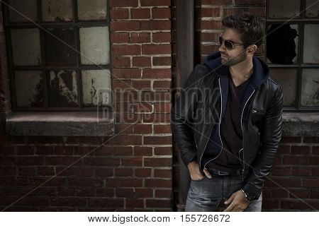 Jeans and jacket guy on street at night