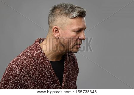 Studio Shot Of Serious Mid Age Man