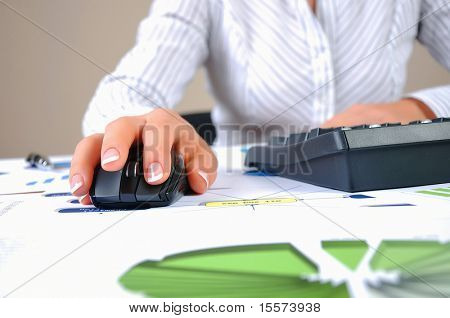 Workplace businessman. Charts, securities, charts on your desktop