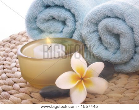 Frangipani,Candle And Blue Towel On Mat