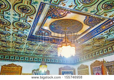 KAIROUAN TUNISIA - AUGUST 30 2015: The ceiling in Guests Room of Mansion of Governor covered with fretwork painted in blue gamma on August 30 in Kairouan.