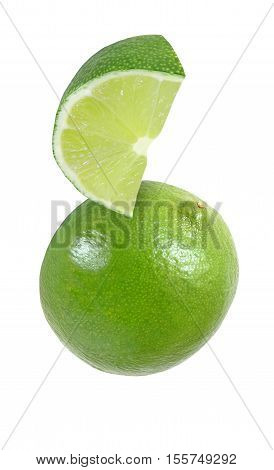 hanging falling hovering flying piece of lime fruits isolated on white background with clipping path