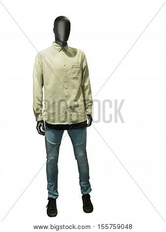 Full length male mannequin dressed in shirt and blue jeans isolated on white background. No brand names or copyright objects.