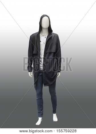 Full-length male mannequin dressed in a jacket with a hood and blue jeans isolated. No brand names or copyright objects.