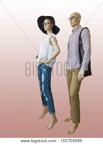 Two mannequins male and female dressed in fashionable clothes isolated. No brand names or copyright objects.